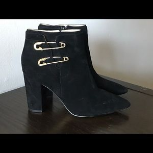 Ankle boot with safety pin detail.